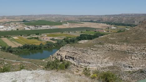 Spain-Ebro-River-Near-Sastago-With-Fields-And-Cliffs