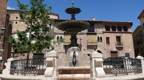 Spain-Mora-De-Rubielos-Fountain-With-Fish-And-Blue-Sky