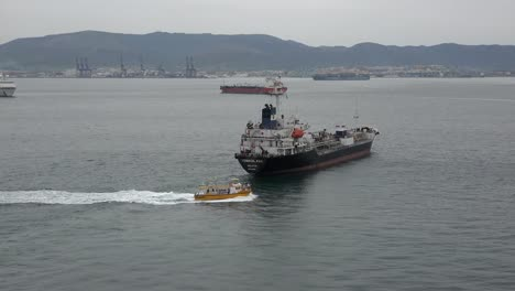 Spain-Boat-Passes-Freighter-In-The-Mediterranean-Off-Gibraltar