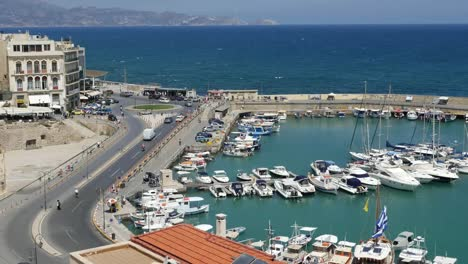 Greece-Crete-Heraklion-Boats-In-Harbor-By-Road
