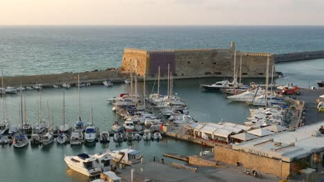Greece-Crete-Heraklion-Harbor-With-Fort-In-Evening