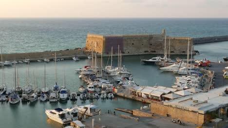 Greece-Crete-Heraklion-Harbor-With-Fort-In-Evening