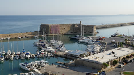 Greece-Crete-Heraklion-Harbor-With-Fort-In-Morning