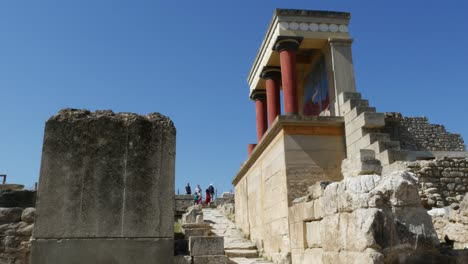 Greece-Crete-Knossos-Restored-Ruin-Side-View-With-Tourists