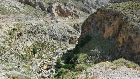 Greece-Crete-Kourtaliotiko-Gorge-With-Large-Rock-Above-Stream
