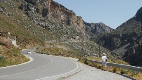 Greece-Crete-Kourtaliotiko-Gorge-Woman-By-Road