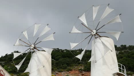 Greece-Crete-Lasithi-Plateau-Two-Windmills-Turning-In-Wind