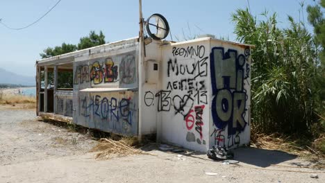 Greece-Crete-Graffiti-On-An-Abandoned-Food-Stand
