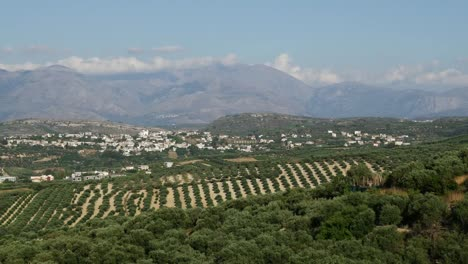 Greece-Crete-Landscape-With-Groves-Town-And-Mountains