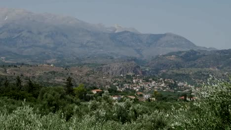 Greece-Crete-Olive-Groves-And-Village-Houses-With-Mountains