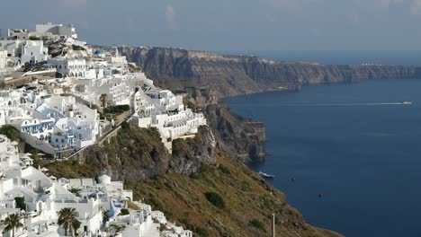 Greece-Santorini-Fira-Caldera-Rim-Little-Boat-Leaving
