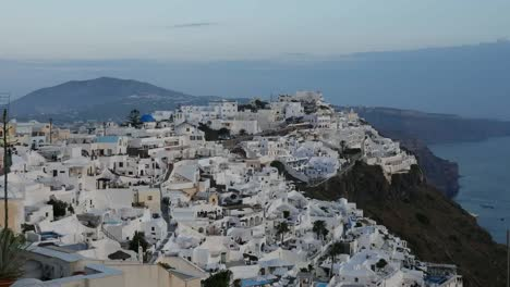 Greece-Santorini-Fira-In-Evening-With-Mountain
