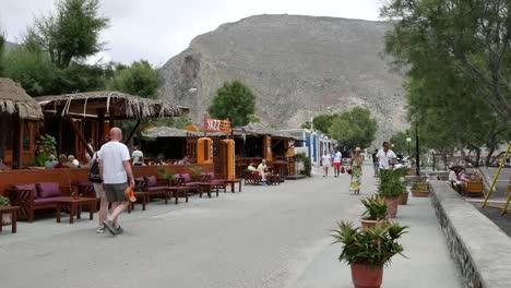 Greece-Santorini-Perissa-Tourists-And-Cafes