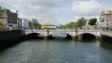 Ireland-Dublin-River-Liffey-Bridge-With-Yellow-Buses