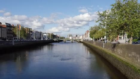 Ireland-Dublin-River-Liffey-With-Clouds-In-Blue-Sky-Zoom-In