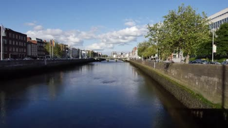 Ireland-Dublin-River-Liffey-With-Clouds-In-Blue-Sky