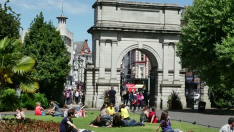 Ireland-Dublin-St-Stephens-Green-Fusiliers-Arch-With-People-Resting