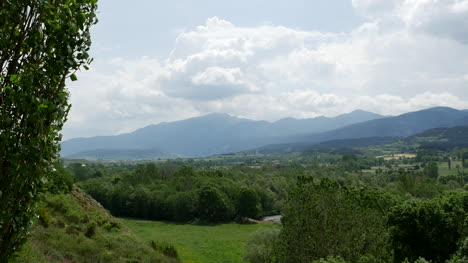 Spain-Pyrenees-Clouds-Over-Wooded-Hills-And-Fields