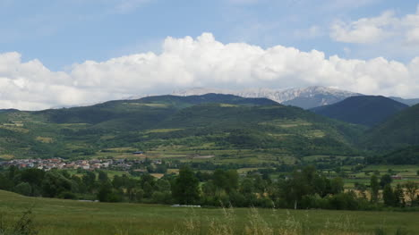 Spain-Pyrenees-Mountains-Capped-By-A-Cloud