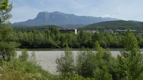 Spain-Pyrenees-River-And-Mountain