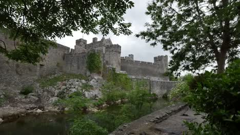 Ireland-Cahir-Castle-On-River-Framed-By-Trees