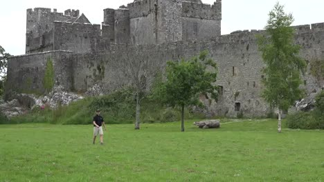 Ireland-Cahir-Castle-With-Man-Playing-Disk-Golf-Zoom-Out