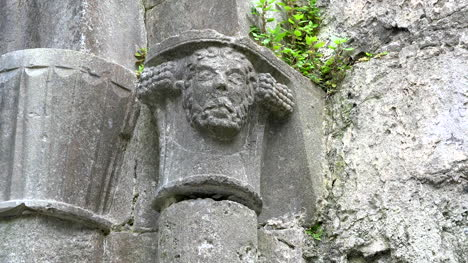 Ireland-Corcomroe-Abbey-Carved-Head-Above-Column-Zoom-Up