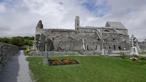 Ireland-Corcomroe-Abbey-With-Flowers-In-Cemetery