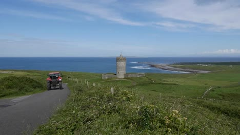 Ireland-County-Clare-Doonagore-Castle-With-Passing-Tractor