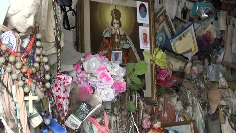 Ireland-County-Clare-Statues-And-Other-Offerings-At-St-Brigids-Holy-Well-Pan