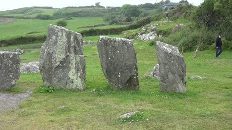 Ireland-County-Cork-Drombeg-Stone-Circle-With-Man-Walking