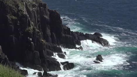 Ireland-Dingle-Coastal-Waves-Hitting-Cliffs-Zoom-And-Pan