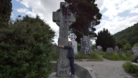 Ireland-Glendalough-Celtic-Monastery-Woman-Hugs-High-Cross