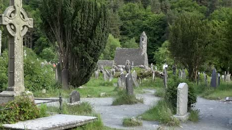 Ireland-Glendalough-St-Kevins-Celtic-Cross-And-Church-Zoom-Out