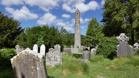 Ireland-Glendalough-Round-Tower-At-Celtic-Monastery-With-Tombstones