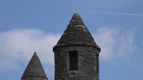Ireland-Glendalough-Round-Tower-Top-With-Bird