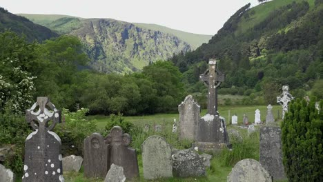 Ireland-Glendalough-With-Cemetery-And-High-Cross-In-Mountain-Valley