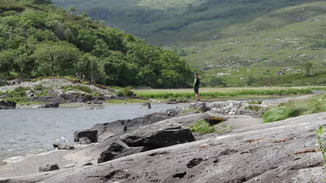 Ireland-Killarney-National-Park-Man-Standing-By-Lough-Leane-Zoom-In
