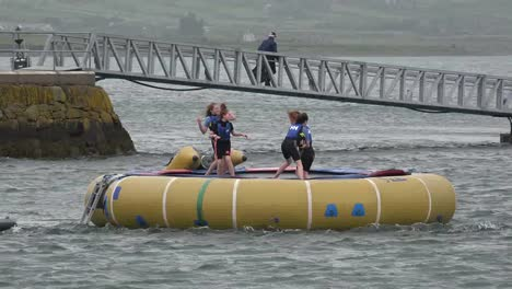 Ireland-Ring-Of-Kerry-Kids-Jumping-On-Float-With-Man-On-Bridge