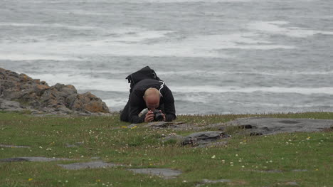 Ireland-The-Burren-Man-Photographing-A-Flower-On-The-Ground-
