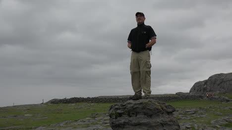 Ireland-The-Burren-Man-Standing-On-Cliff