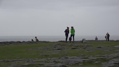 Ireland-The-Burren-Tourists-Walking-Along-