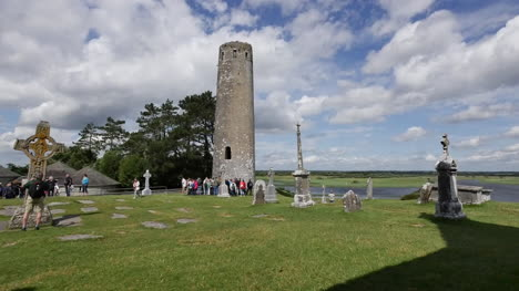 Ireland-Clonmacnoise-A-High-Cross-And-A-Tour-Group-At-A-Round-Tower