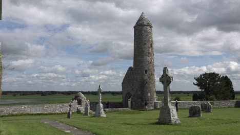 Ireland-Clonmacnoise-A-Round-Tower-Stands-Amid-Celtic-Crosses-By-The-Shannon-River