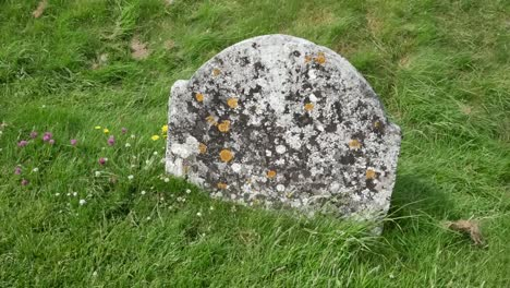 Ireland-Clonmacnoise-A-Small-Tombstone-Covered-With-Lichens