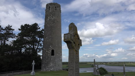 Ireland-Clonmacnoise-Round-Tower-And-High-Cross-In-Shadow