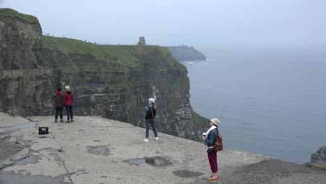 Ireland-County-Clare-Cliffs-Of-Moher-Four-Tourists-Sightseeing-