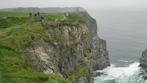 Ireland-County-Clare-People-Along-A-Path-At-Cliffs-Of-Moher-Zoom-Out