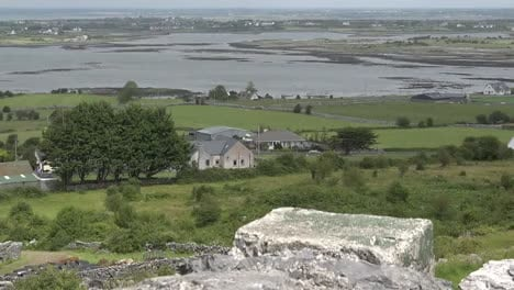 Ireland-County-Clare-Stone-Wall-On-Hillside-Above-Estuary-Zoom-And-Tilt-Up