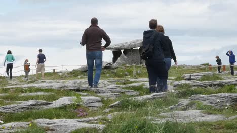 Ireland-County-Clare-Tourists-Walk-Towards-A-Dolmen-Zoom-And-Pan-